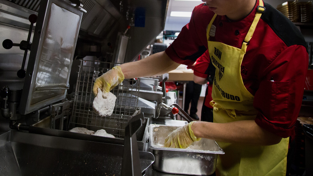 Chick-fil-A employee works the kitchen