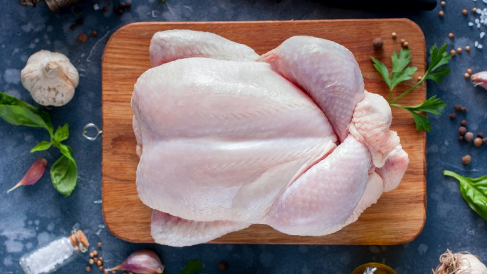 whole chicken on a cutting board