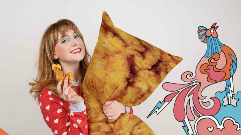 Girl holding A&W chicken tender body pillow