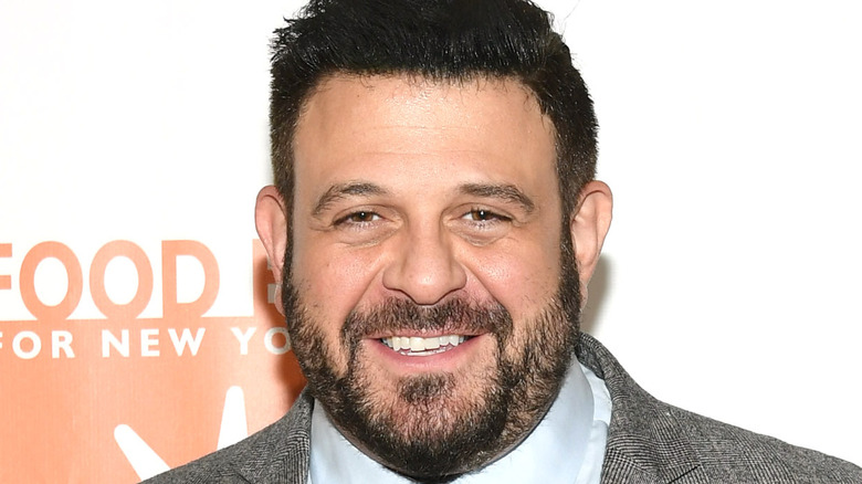 Adam Richman smiling at event