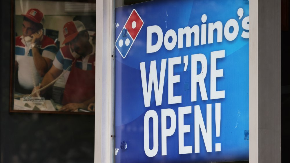 """Domino's sign reading """"we're open"""""""