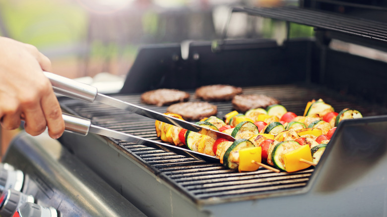 Man cooking on a gas grill
