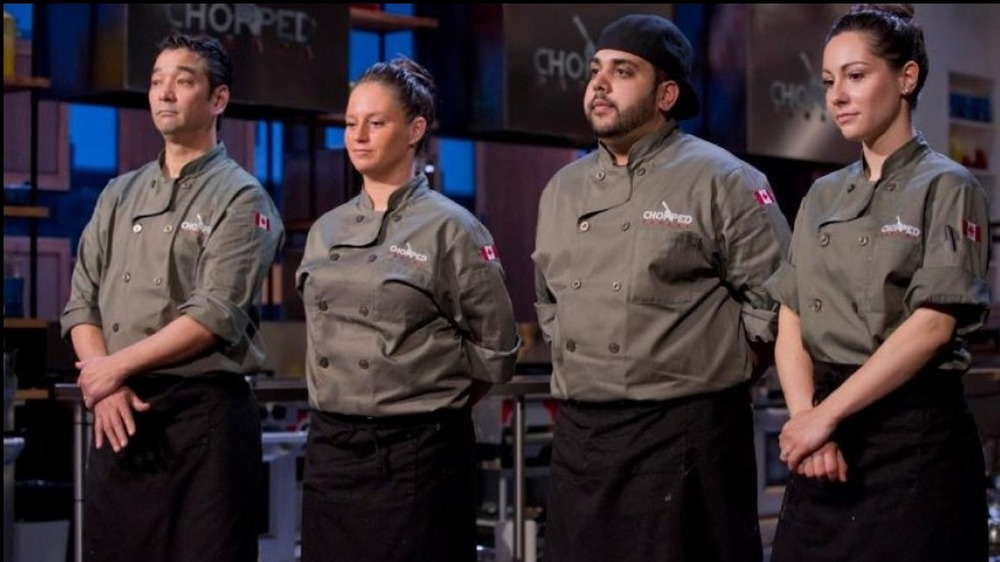 four Chopped contestants in aprons