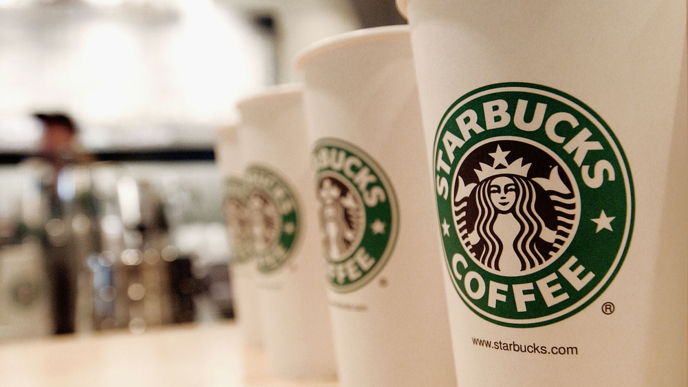 Starbucks coffee cups lined up