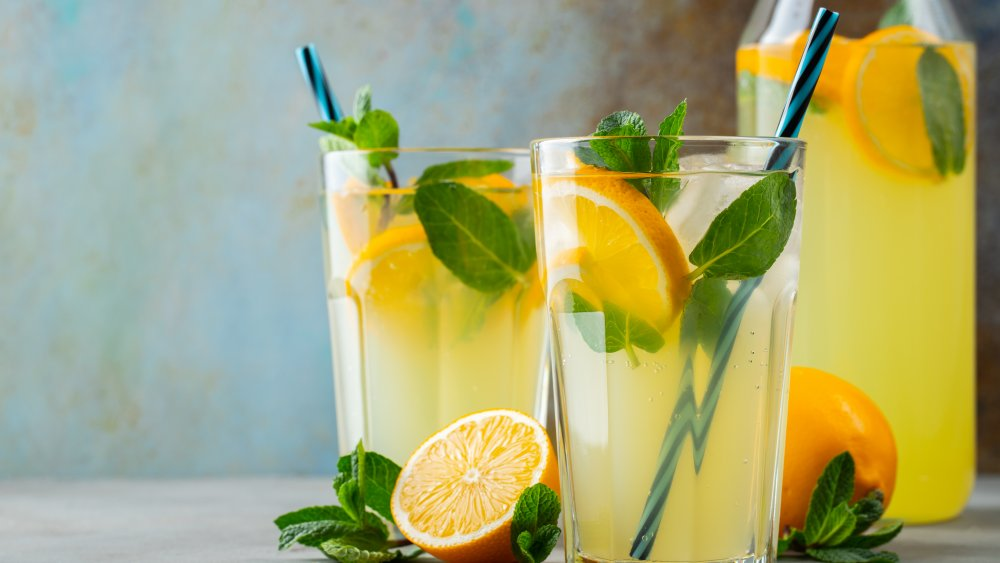 fresh lemonade in two glasses and a pitcher