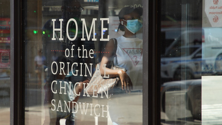 "A sign saying ""Home of the Original Chicken Sandwich."" Is that true? Did no one ever think to slab a flayed chick between breads?"