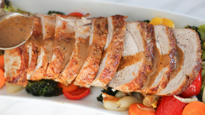 pork loin recipe and vegetables on a pan