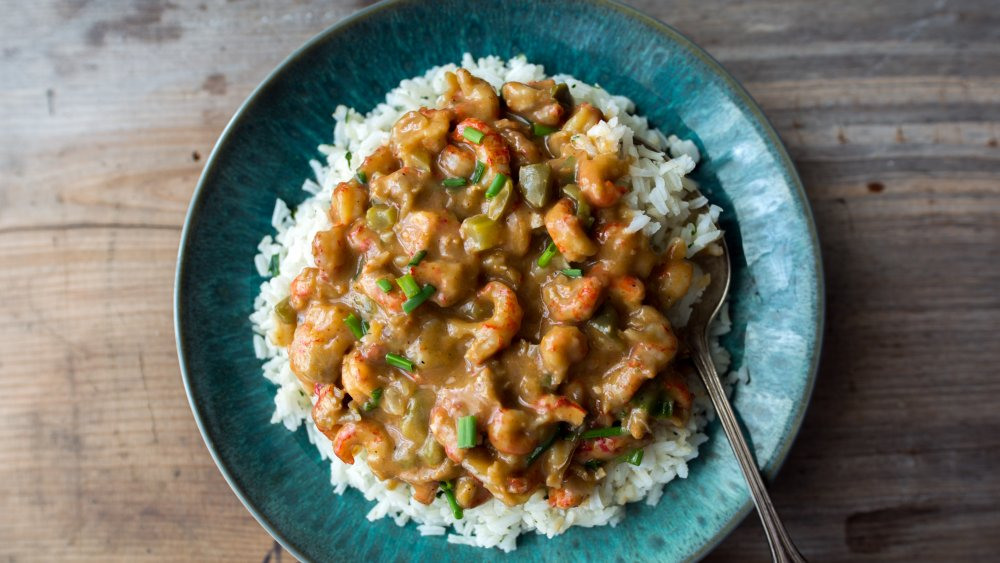 crawfish etouffee served over rice in a blue bowl