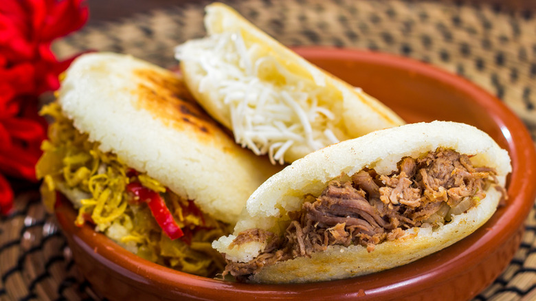 The Real Difference Between Venezuelan And Colombian Arepas