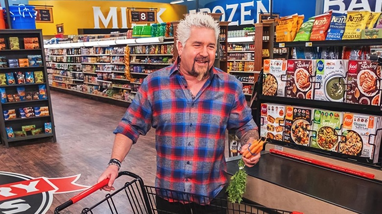 guy fieri shopping on a grocery store set