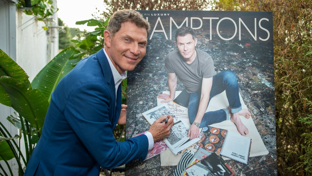 Bobby Flay signs a poster
