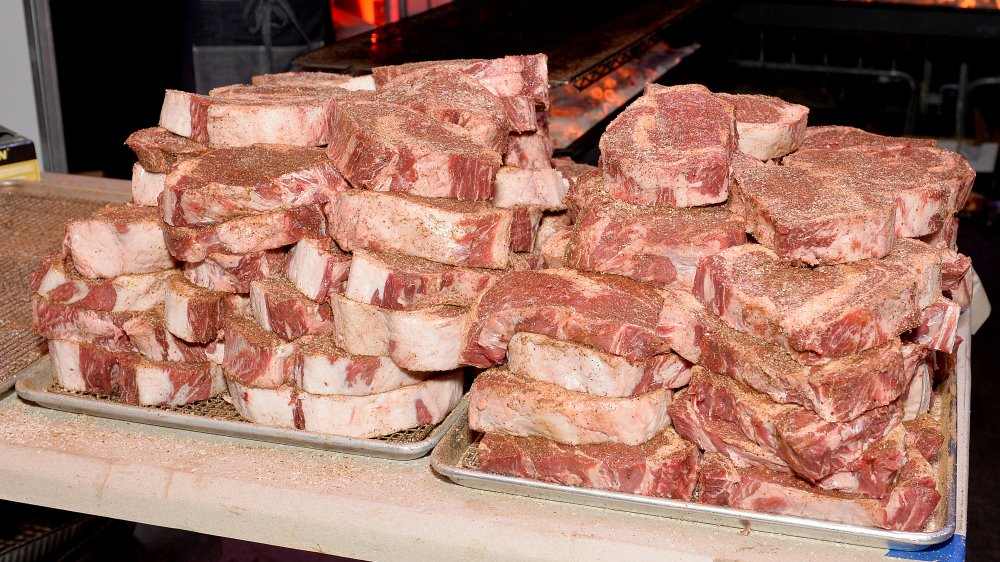 A pile of uncooked steaks looking oh so appetizing.