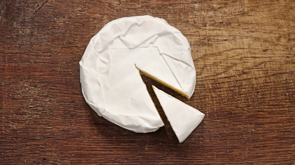 Brie cheese with a slice cut out