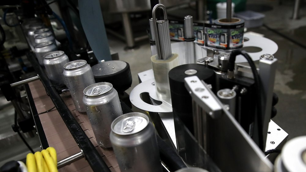 aluminum cans on an assembly line