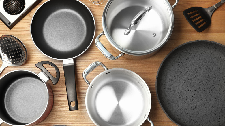 Pots and pans on a wood surface