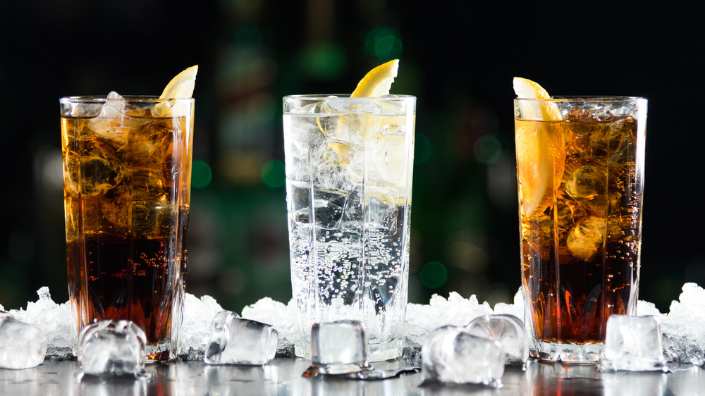 Two brown cokes and one white soda