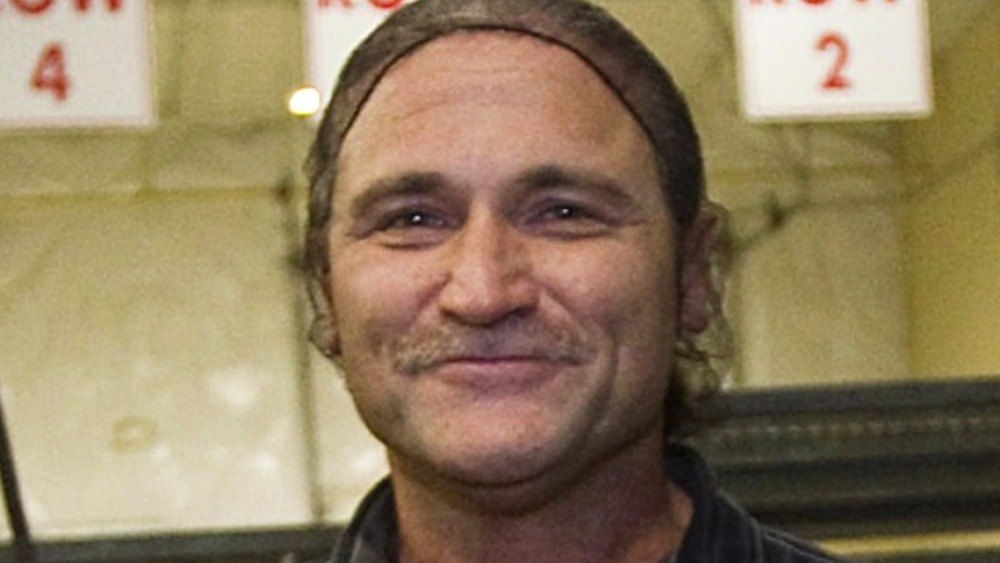 "Dave Dahl displays loaves of his ""killer"" bread"
