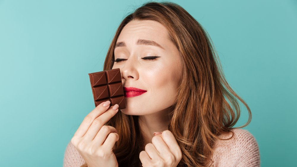 woman smelling chocolate