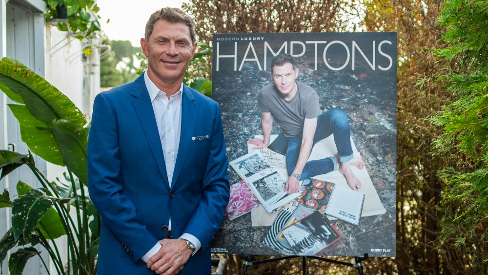 Bobby Flay in front of a poster