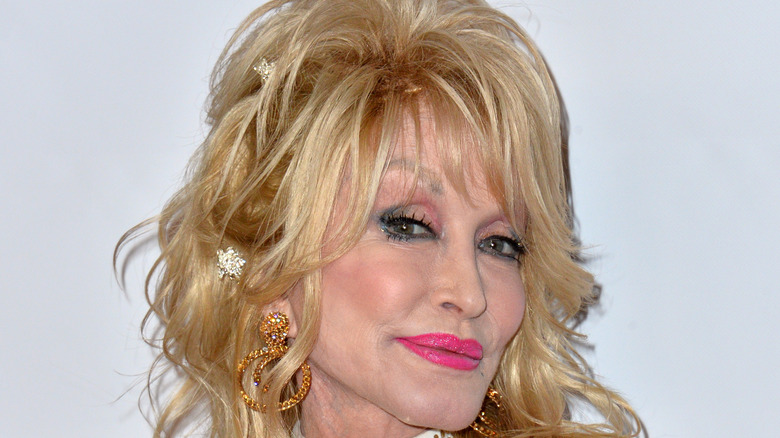 Dolly Parton wearing pink lipstick