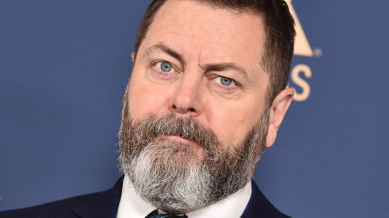 Closeup of Nick Offerman wearing suit and tie