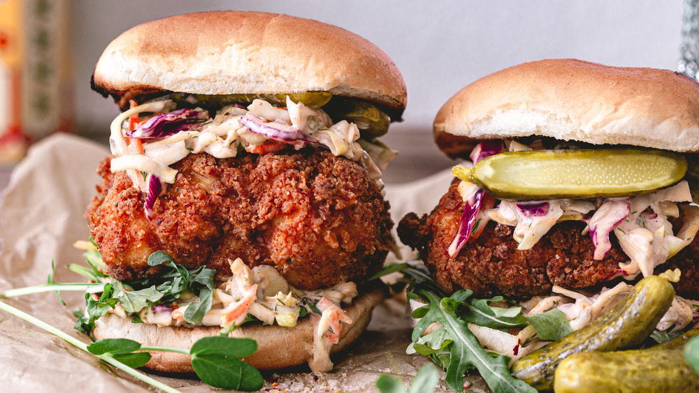 Two fried chicken sandwiches with coleslaw
