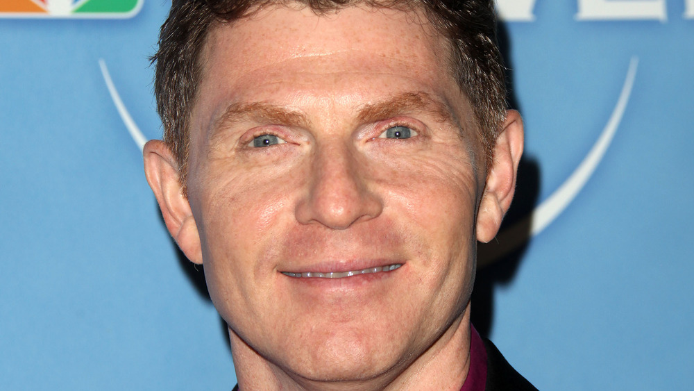 Bobby Flay attending press tour party