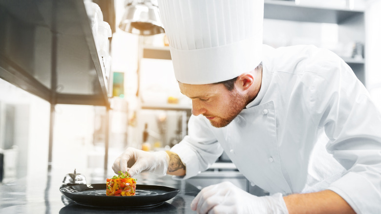 chef wearing a toque in a kitchen