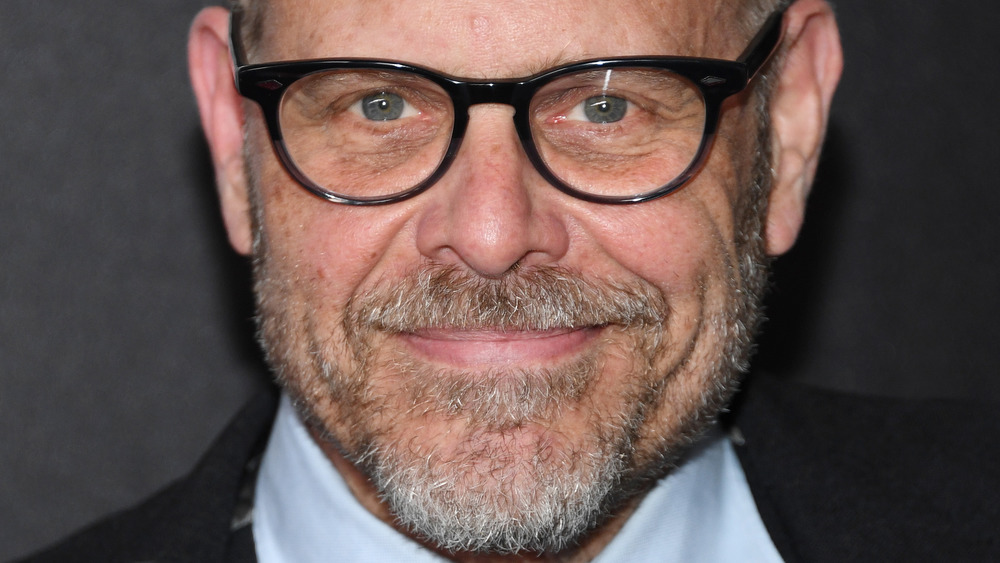 Alton Brown smiling with black glasses
