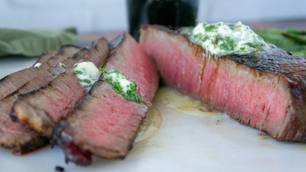 sliced steak with herb butter
