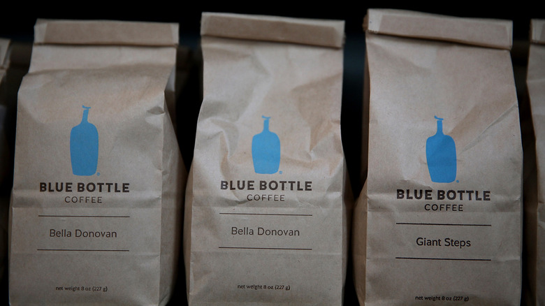 Three brown bags of Blue Bottle Coffee