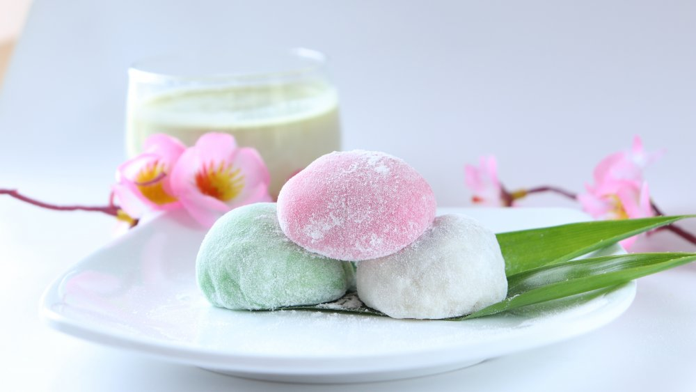 Colourful mochi ice creams arranged in an oriental setting