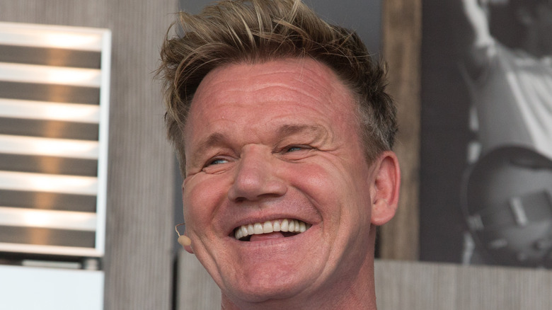 Gordon Ramsay laughing into microphone