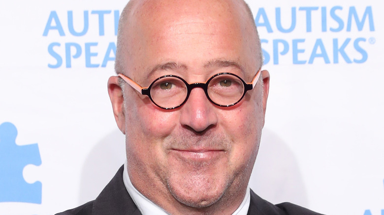 Andrew Zimmern with black and pink glasses