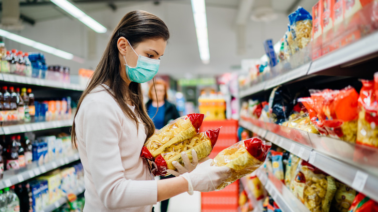 Woman evaluating food labels