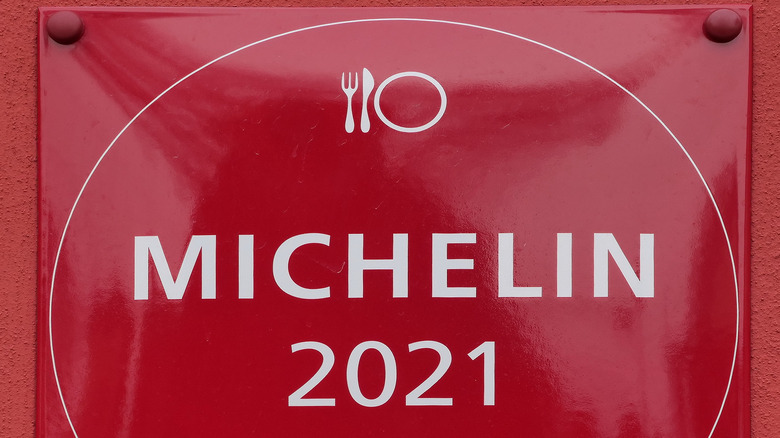 "Red sign reading ""Michelin 2021"""