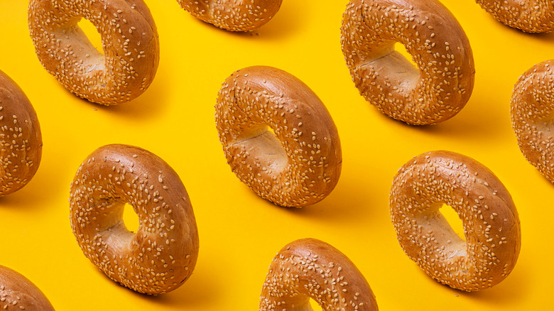 sesame bagels on yellow background