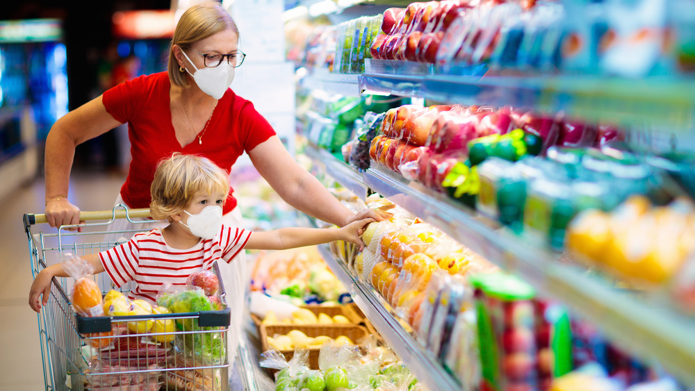 Woman and child grocery shopping