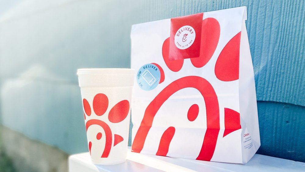 Chick-fil-A takeout bags and soda cup