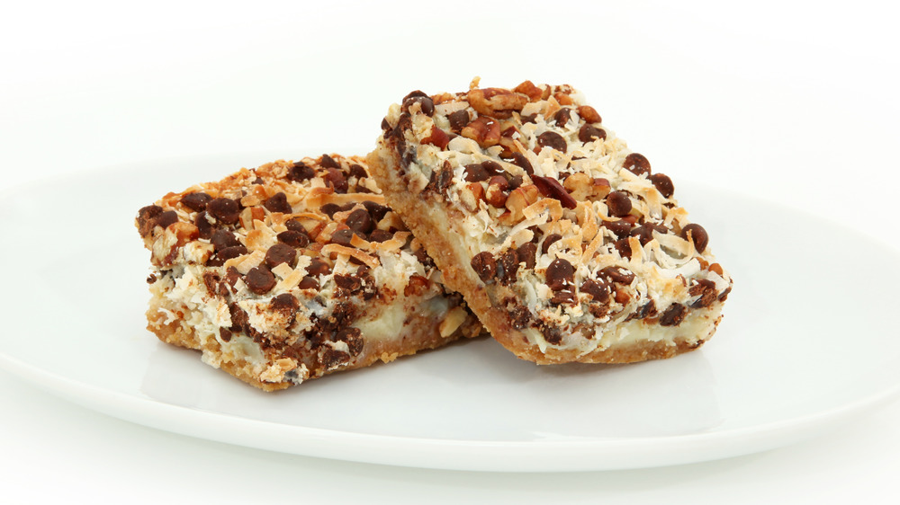 Magic cookie bars on a white plate
