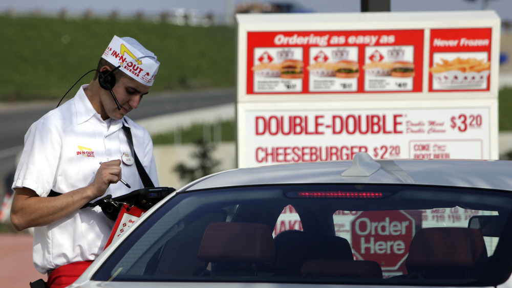 In-N-Out worker takes a drive-thru order