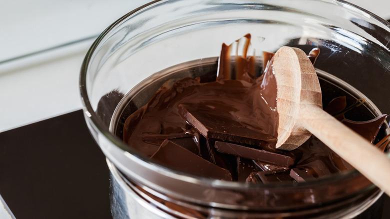 tempering chocolate over a double boiler wooden spoon