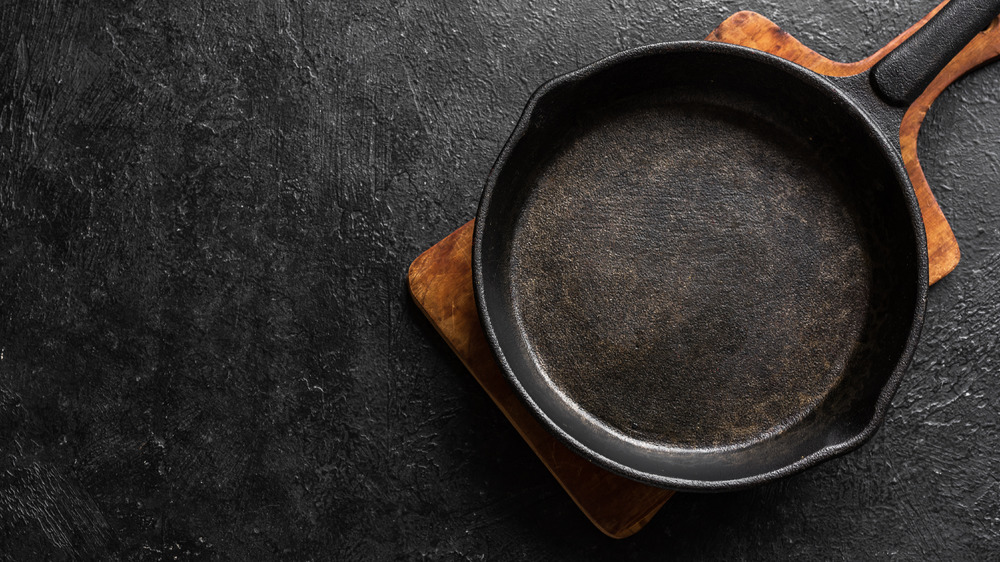 Cast iron skillet on wooden board