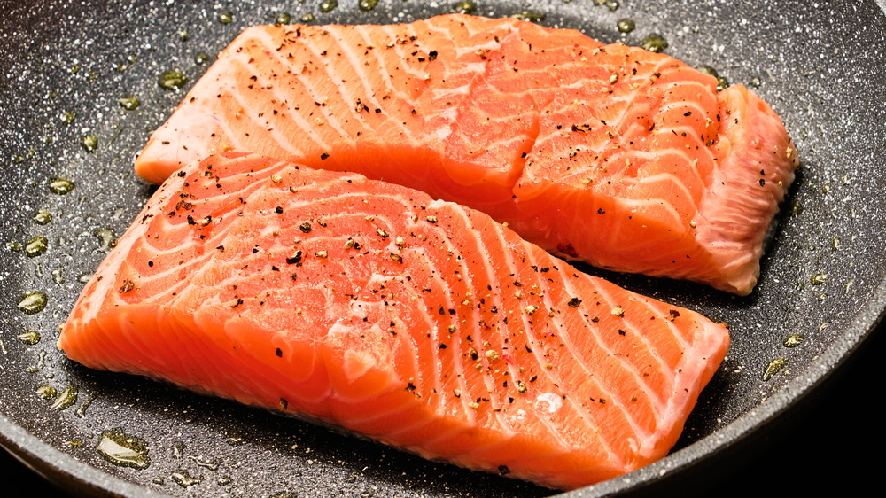 Salmon cooking on stove