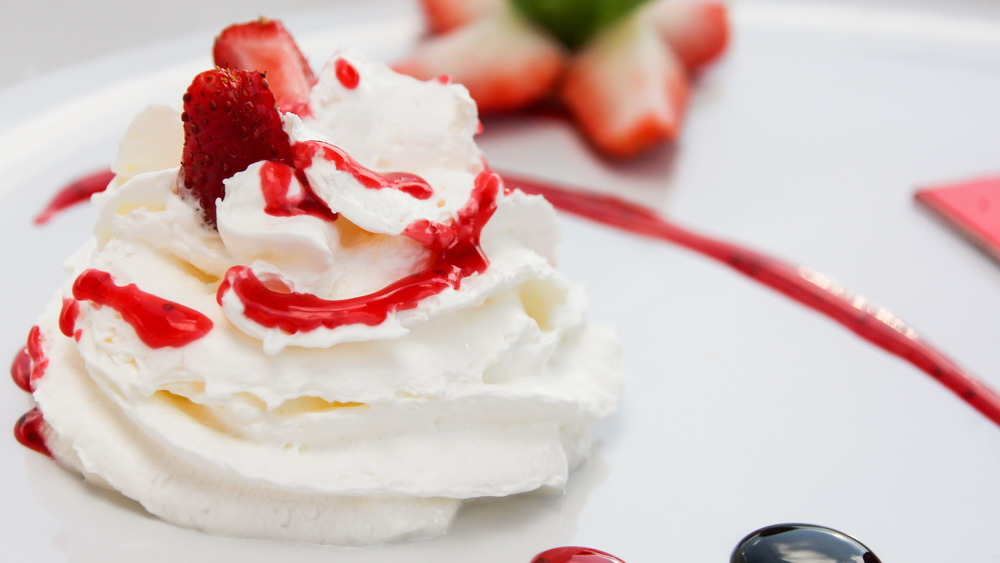 Whipped cream with strawberry sauce