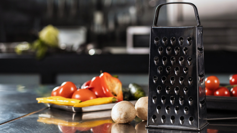 A box grater with vegetables