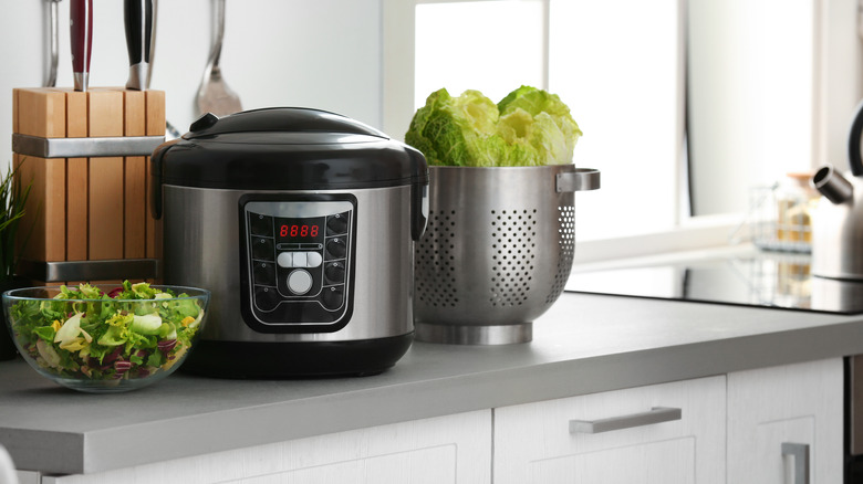 Slow cooker on kitchen counter