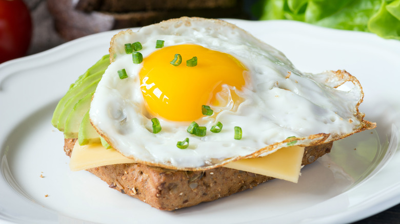 Sunny-side up egg on toast with cheese
