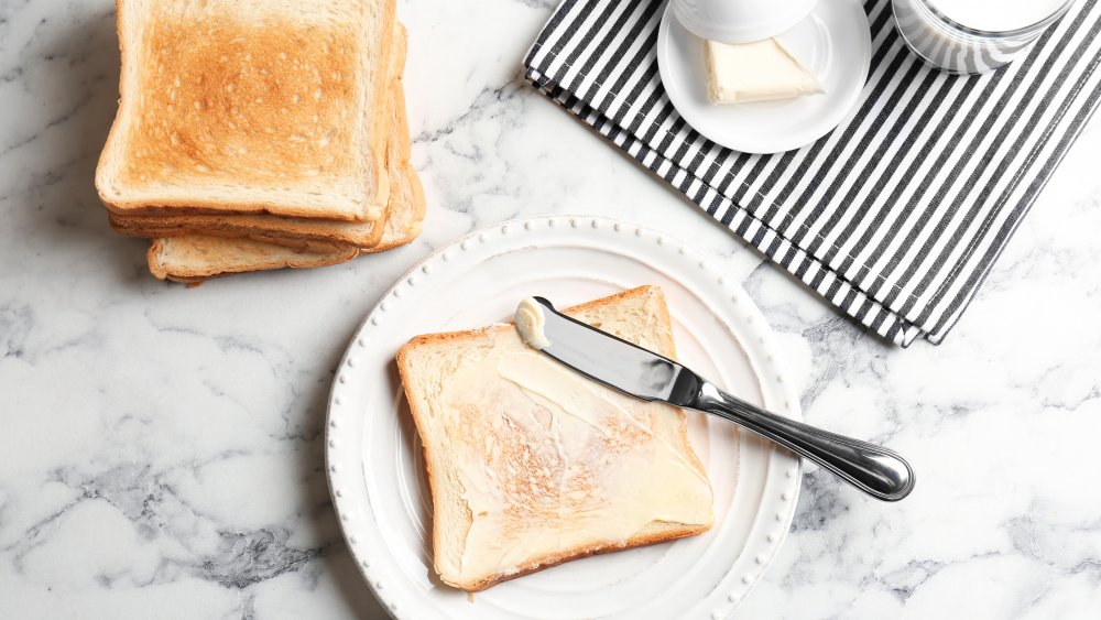 toast and butter on table