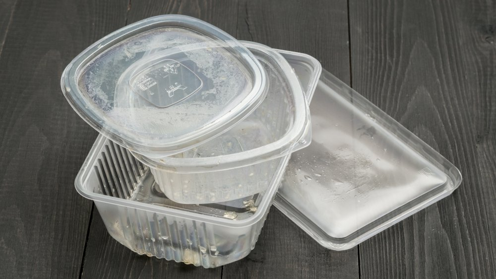 plastic food containers against a wooden background